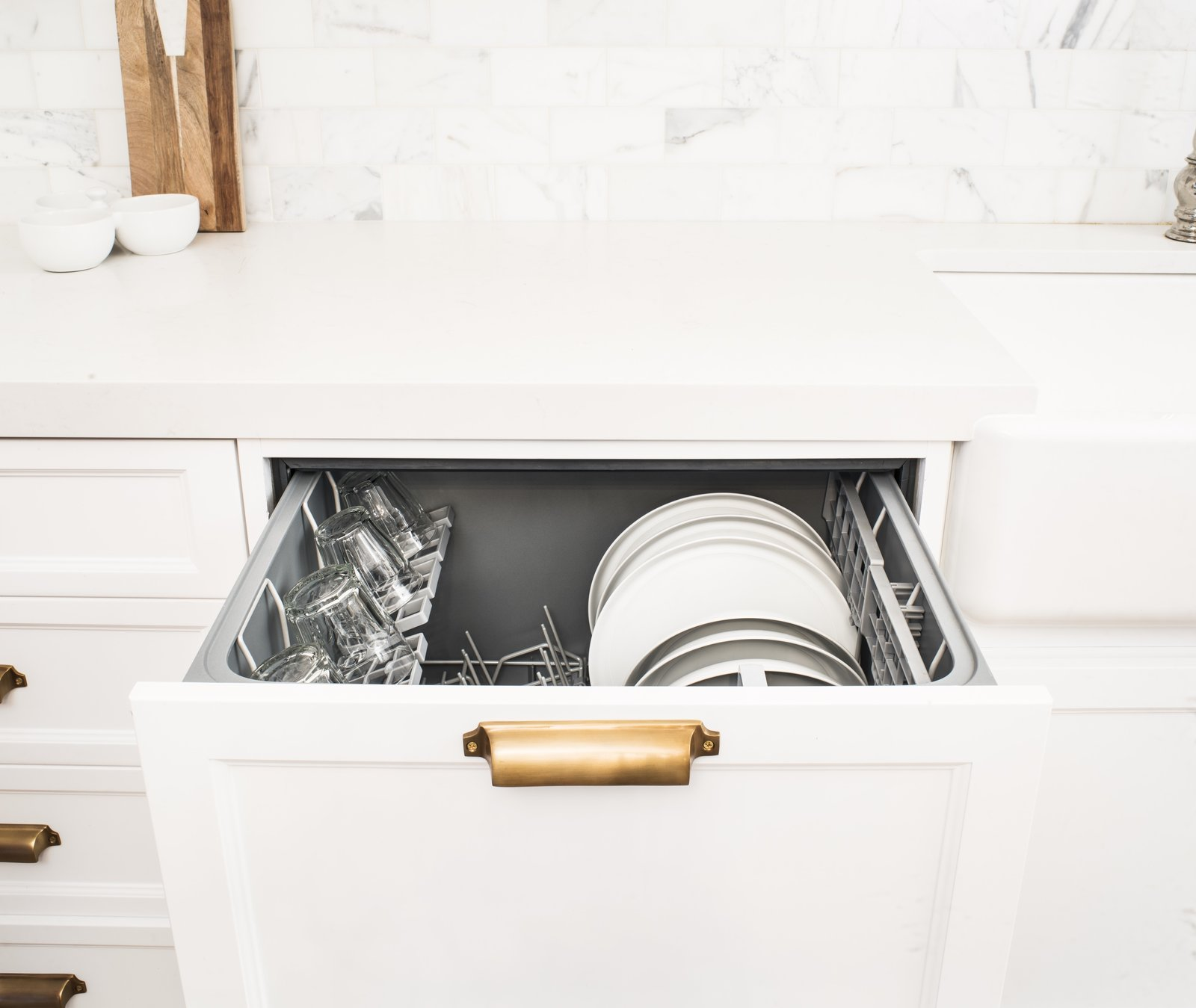 Nine wash cycles vary from delicate to heavy duty; a flow-through detergent dispenser and 163°F water help sanitize dishes.  Photo 6 of 8 in An Interior Designer's Streamlined Kitchen