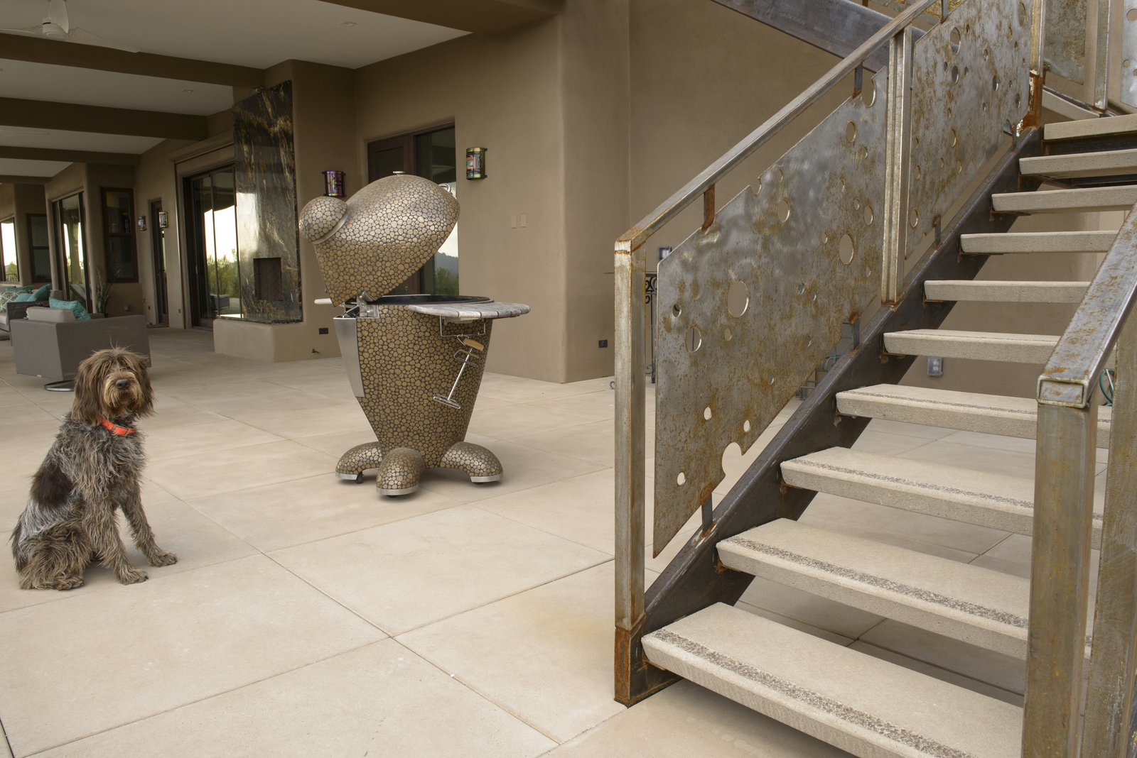 Offering 12 standard colors and a wide assortment of finishes across its product lines, Stepstone allows customers to employ a seamless material palette, as seen in the CalArc Pavers and open riser Steptreads pictured in the home above. Stepstone also offers customizations made in collaboration with architectural and landscape design communities.  Photo 4 of 7 in Setting Creative Solutions in Stone