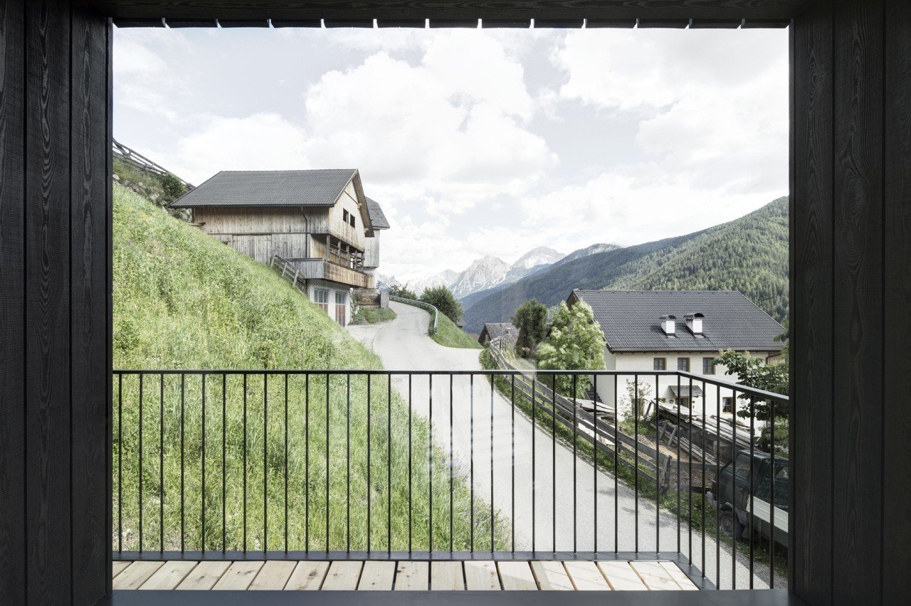 Outdoor and Wood Patio, Porch, Deck The loggia-inspired balcony, a fixture of the region's architecture, protects guests from harsh winds.  Photo 3 of 12 in Find Sanctuary in This Chalet in the Italian Alps