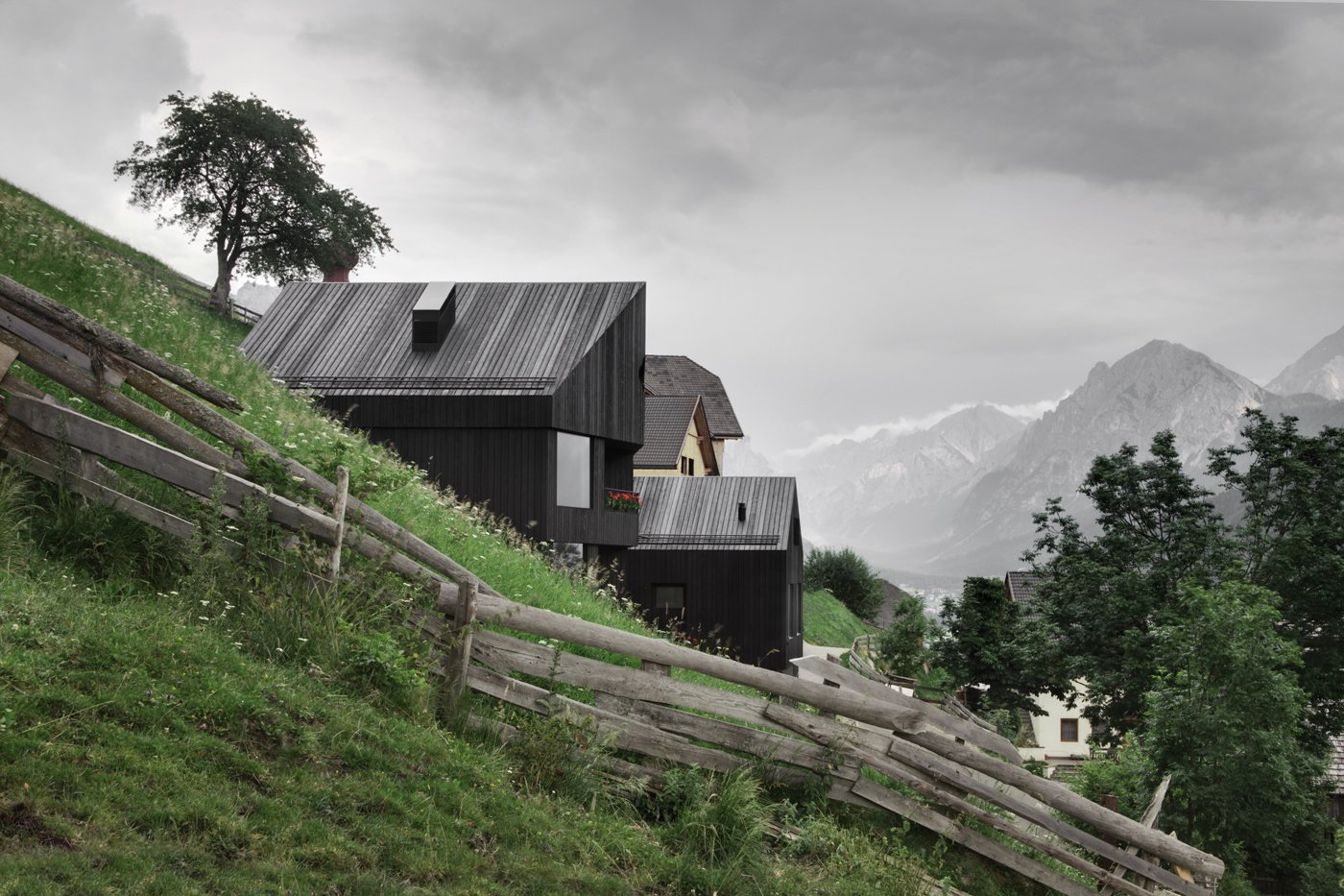 Outdoor, Trees, Slope, Horizontal Fences, Wall, Wood Fences, Wall, and Grass Guests can buy fresh cheese, milk, and eggs from the neighbors.  Photo 11 of 12 in Find Sanctuary in This Chalet in the Italian Alps