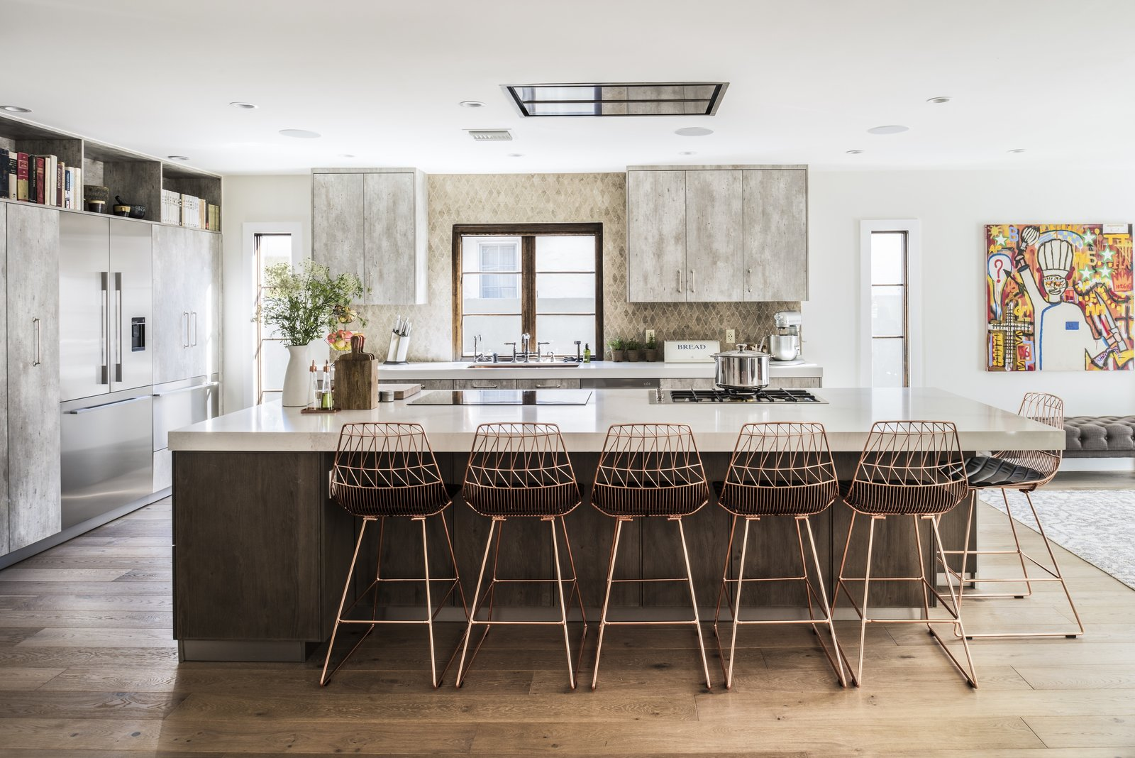 One of the elements that Lefebvre had his heart set on was a copper sink, though it didn't go along with the rest of the decor; the copper bar stools were a serendipitous find that tied the room together.  Photo 2 of 8 in Chef Ludo Lefebvre's Modern Kitchen With Rustic Roots
