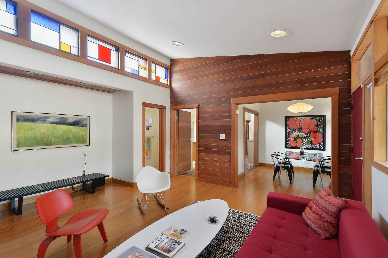 Clerestory windows, outfitted with stained glass in the living room, allow light to bathe nearly every room.  Photo 3 of 12 in Artists Need Apply: This Midcentury Home Comes With an All-Purpose Workshop for $949K