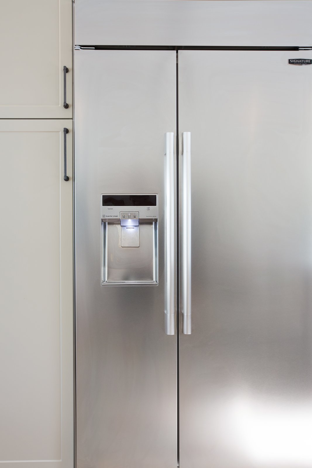 "Lewis also installed the 42"" Built-In Side-By-Side Refrigerator, which features a SmartSpace™ system that embeds the ice dispenser in the freezer door, freeing up storage space. The adjustable cantilevered shelves add even more capacity and move with a touch of a button. In keeping with the sleek aesthetic of the kitchen, the fridge also has an LED touch control panel. Lewis can use her phone to monitor energy use, delay defrosting, and check on the fridge's performance with Smart Diagnosis.dd a caption  Photo 6 of 8 in A Sneak Peek Into an Interior Designer's ""No Ordinary Kitchen"" Renovation"