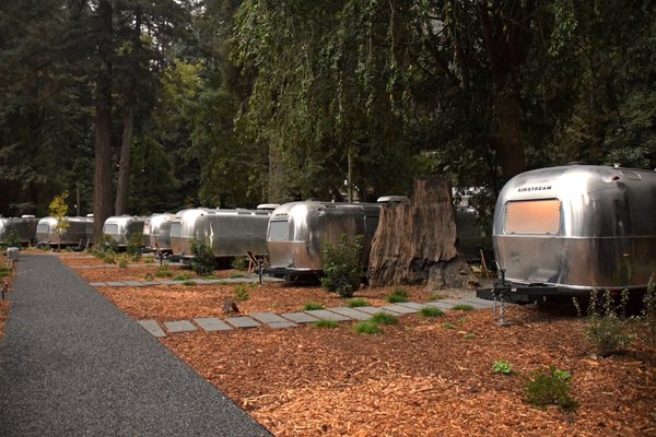 Dan Weber Architecture collaborated with Airstream USA to create the custom trailers at AutoCamp. The clear, non-tinted windows lend vintage charm and  illuminate the grounds as evening sets in.