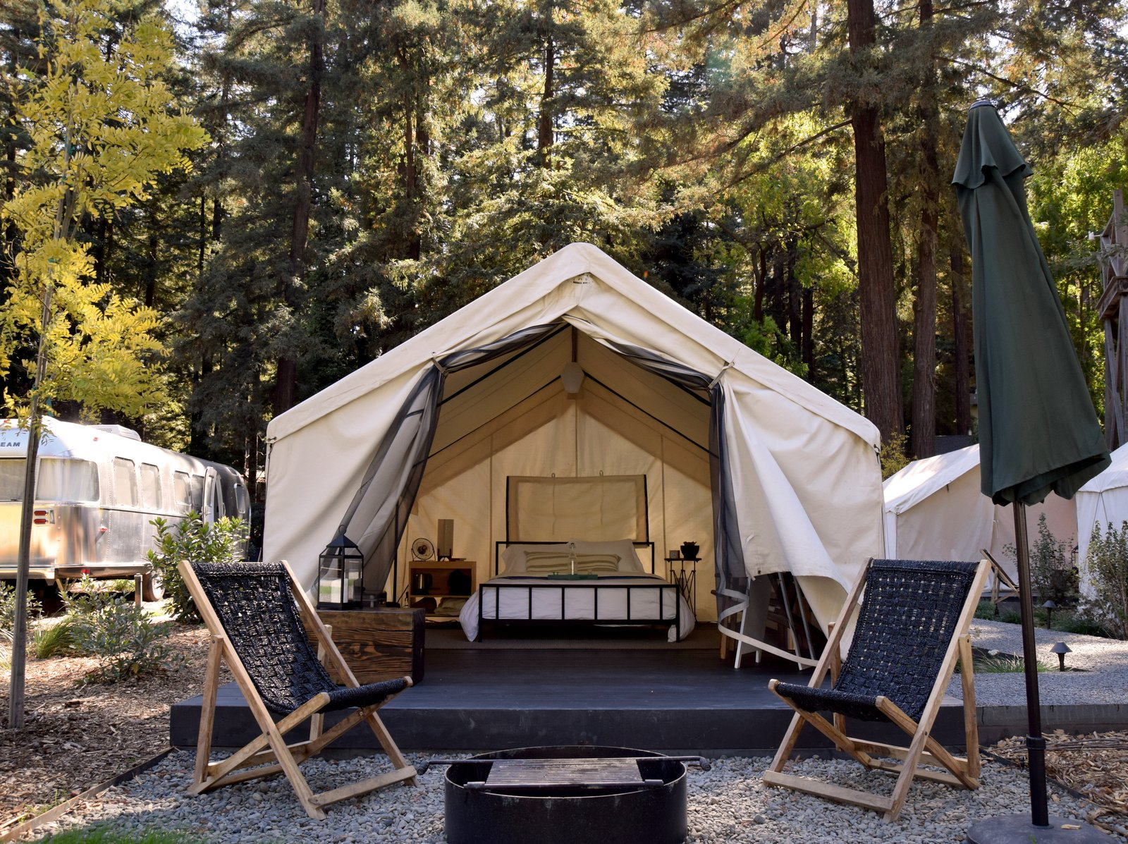 Exterior, Tent Building Type, and Airstream Building Type Outside each tent is a patio area outfitted with lounge chairs and a fire pit. At night, an electric blanket keeps things toasty.  Photo 7 of 10 in At AutoCamp, Sleep in a Slice of Americana for $225 a Night