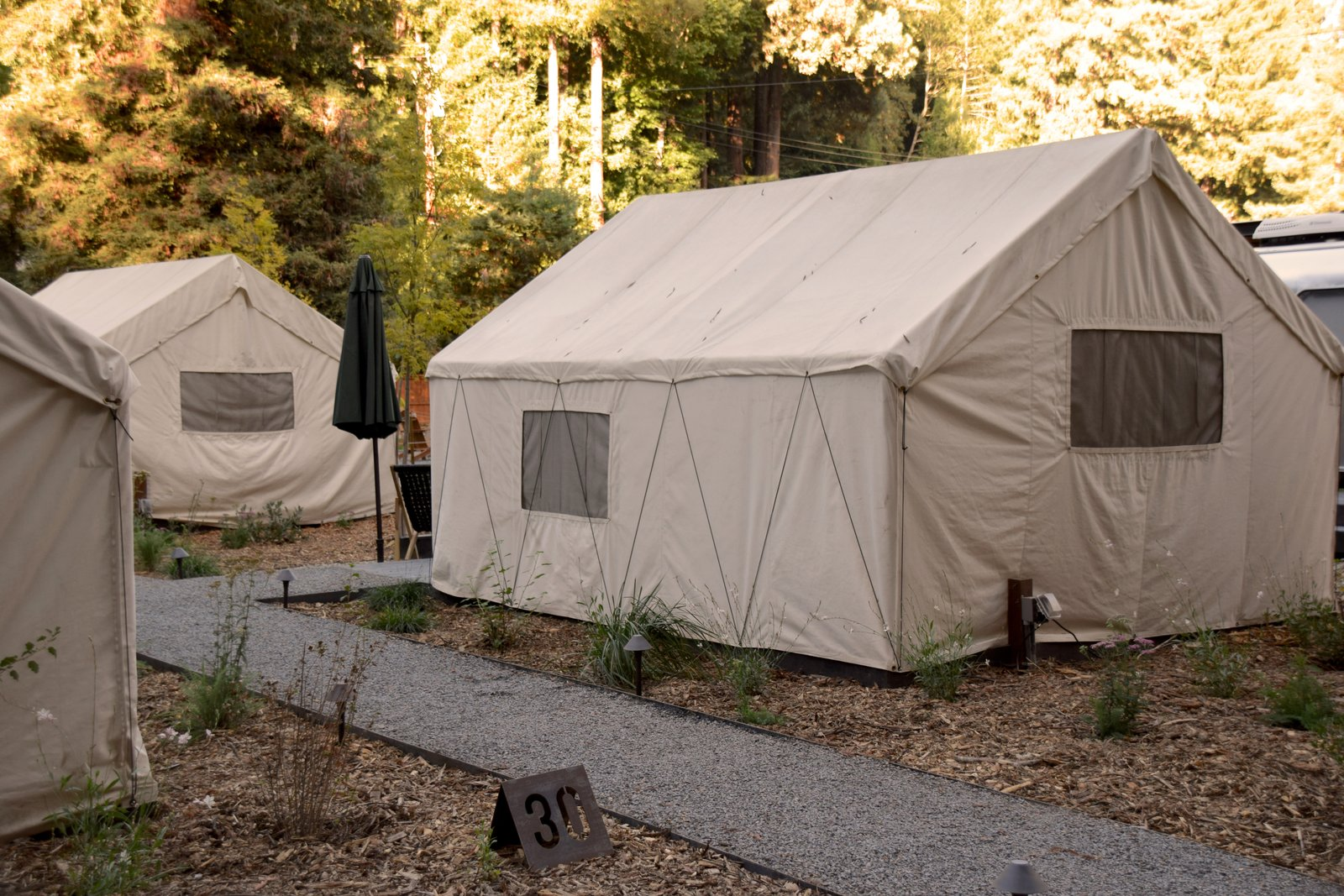 Modern home with Exterior and Tent Building Type. Local landscape design firm Hart Horticulture created an environment of native plants in just one month. Photo 9 of AutoCamp Russian River