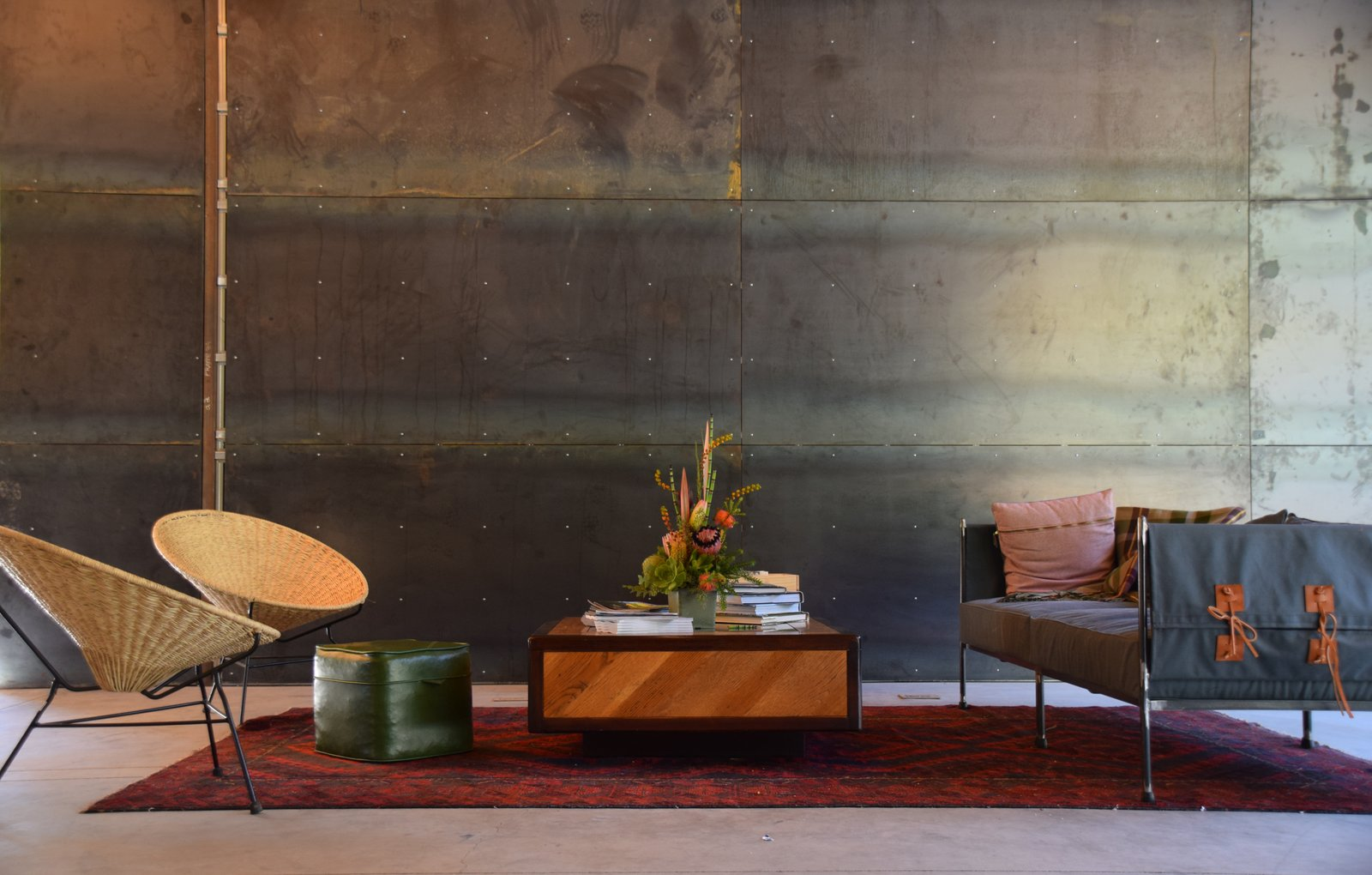 Modern home with Living Room, Coffee Tables, Rug Floor, Chair, Sofa, and Ottomans. Geremia Design created a texturally rich lounge area, its wood, leather, and textile elements softening the steel backdrop. Photo 3 of AutoCamp Russian River