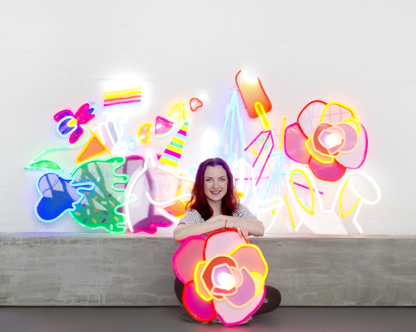 Natalie Jarvis poses with her creations. When she initially conceived of Electric Confetti, she had considered using traditional neon, but its fragility and the presence of mercury drove her to research other alternatives—leading to her discovery of LED neon flex.  Photo 2 of 8 in Next-Generation Neon
