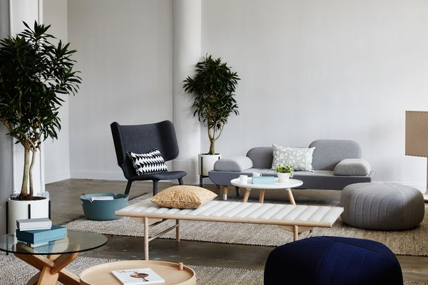 The Tembo Lounge Chair by New Works and an EJ 123 Toward Sofa by Erik Jorgensen lend their sculptural presence to the lounge area, while textiles by Ferm Living and Five Poufs by Muuto provide a counterbalancing softness. The glass-top Ding Table is by Normann Cophagen, and the Align Daybed is by Menu.  Interiors