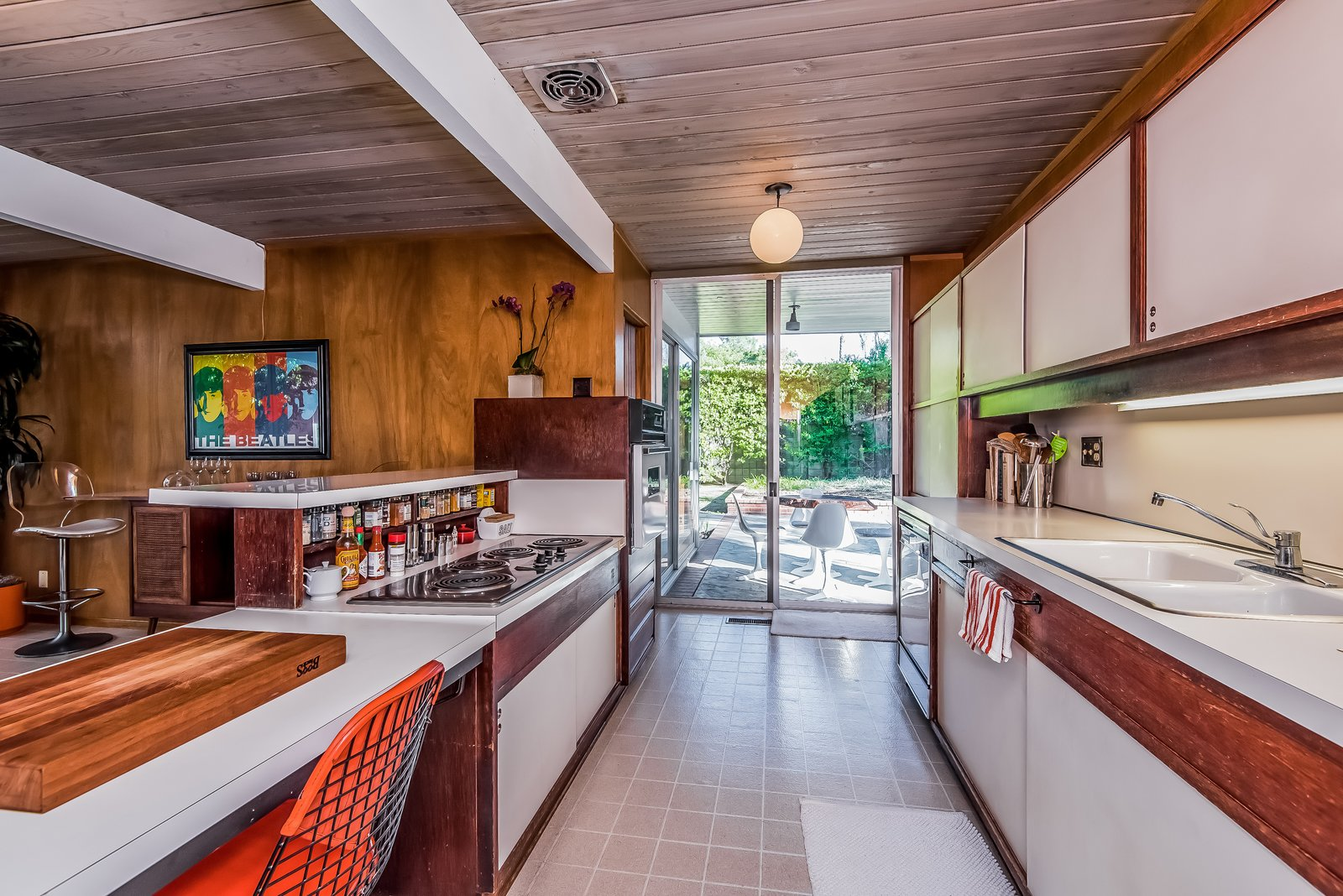 The same patio leads to the all-original kitchen...  Photo 8 of 13 in With Only One Previous Set of Owners, a Pristine Eichler Home Asks $799K
