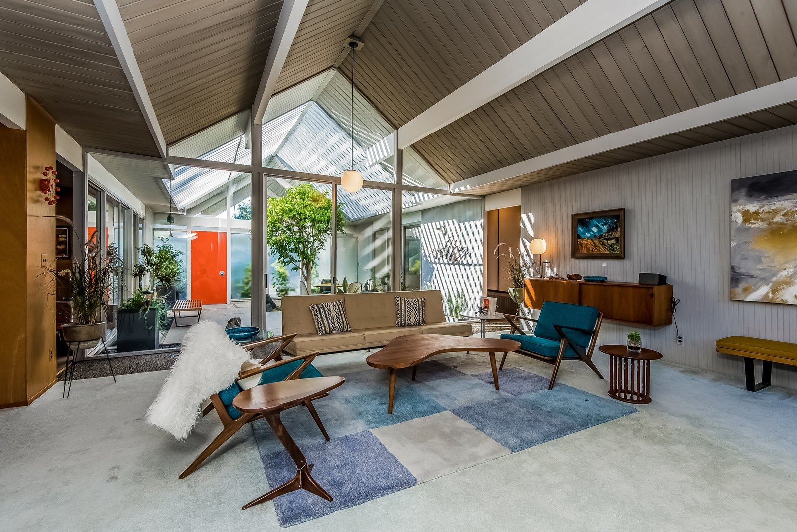 Original tongue-and-groove ceilings and Philippine mahogany paneling grace the interior.  Photo 4 of 13 in With Only One Previous Set of Owners, a Pristine Eichler Home Asks $799K