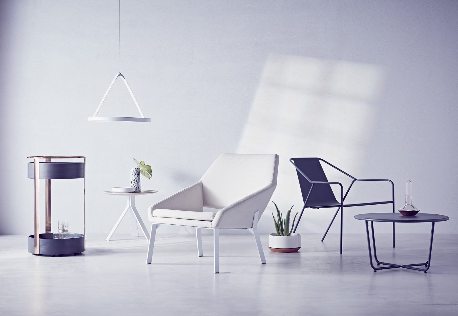 Modern by Dwell Magazine is a holistic home collection, available exclusively through Target starting December 27. Pictured above from left to right: the Bar Trolley in black/copper, $149.99; LED Pendant Light in white, $99.99; Side Table in white/natural, $89.99; Lounge Chair in white/natural, $249.99; Outdoor Lounge Chair in gray, $269.99 for two; Outdoor Side Table in gray, $89.99.  Photo 2 of 10 in The Dwell x Target Lookbook Reveals a Sleek New Collection for the Modern Home