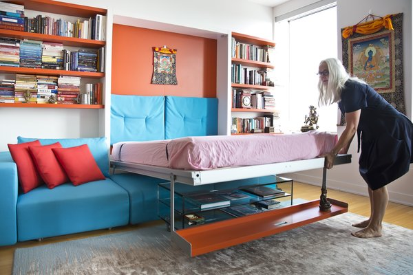 Here's another amazing multipurpose wall bed by Resource Furniture. It's a Murphy bed with couch, coffee table, and storage shelf. In the down position, it fits neatly over the Como Basso, a tempered glass coffee table on casters.