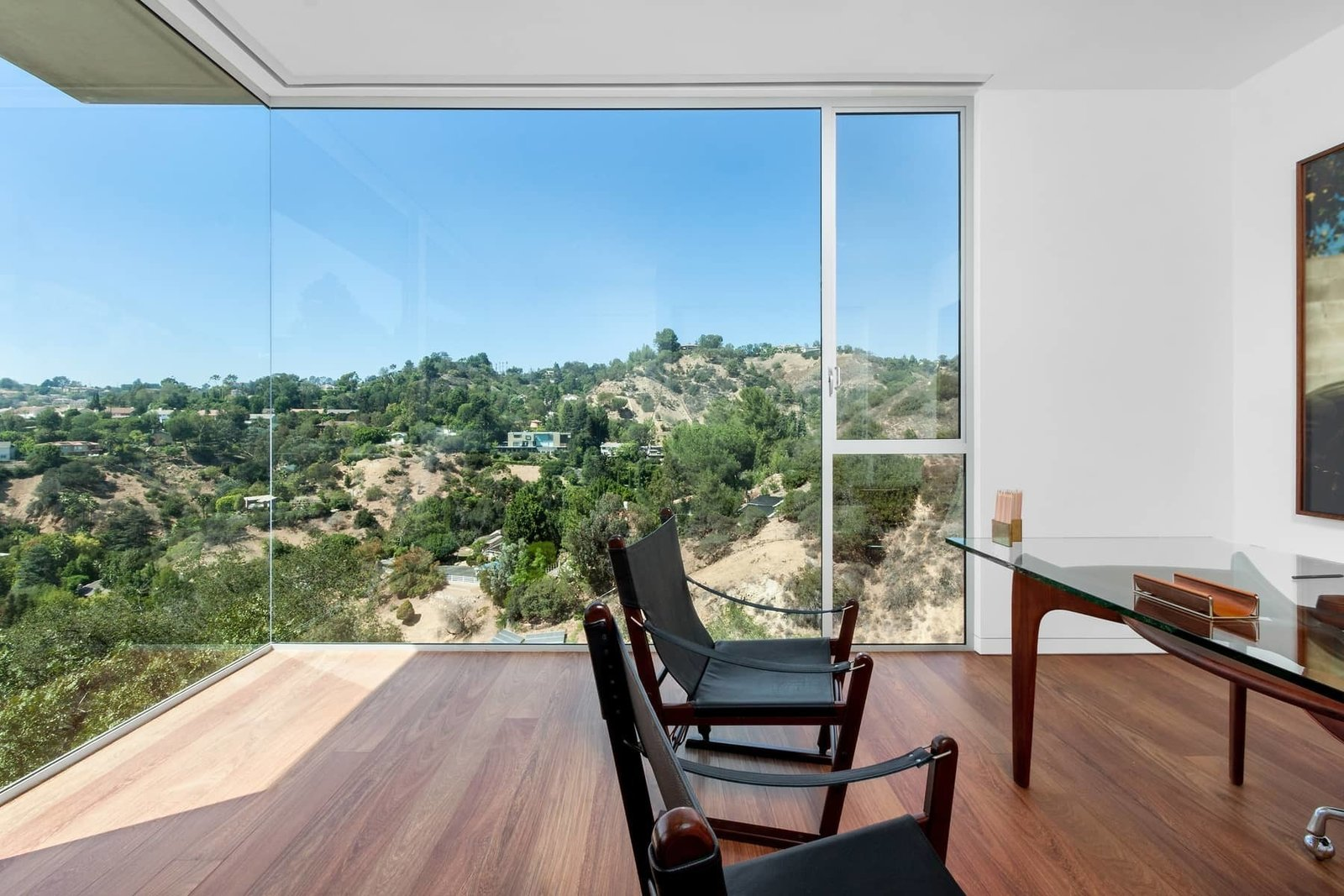 The guest bedroom, shown here as an office, offers an uninterrupted view of the surrounding canyon.  Photo 9 of 10 in A Celeb-Worthy Home in Beverly Hills Asks $6.75M