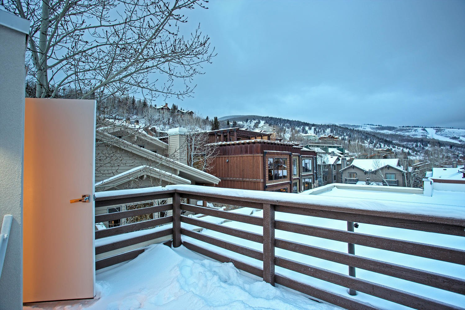 The master bedroom enjoys access to the upper deck.  Photo 9 of 9 in Be at Home With Park City's Slopes For $1.6M