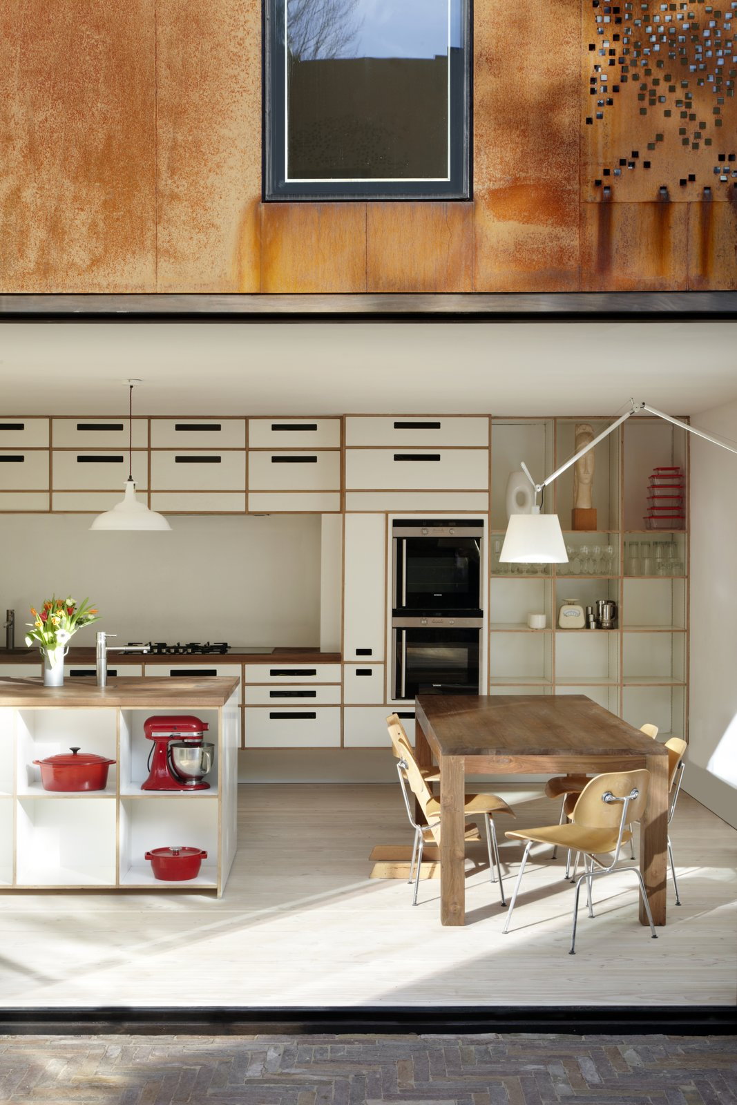Kitchen, Wood Counter, White Cabinet, and Light Hardwood Floor Birch ply cabinets with white melamine facings, walnut worktops, and integrated Siemens appliances create an airy workspace.  Photo 6 of 11 in Weathered Steel Clads a $4.7M Home Near London's Kew Gardens