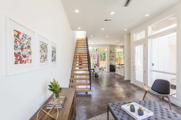A stained concrete floor gleams throughout the first floor.
