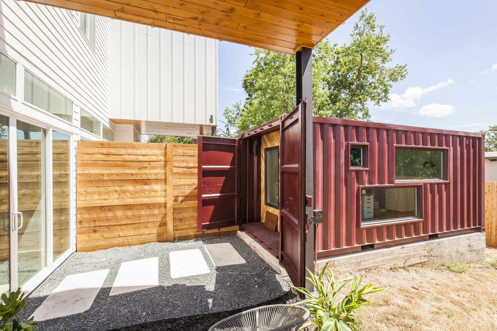 Unit B exterior of removed shipping container addition to home in backyard.