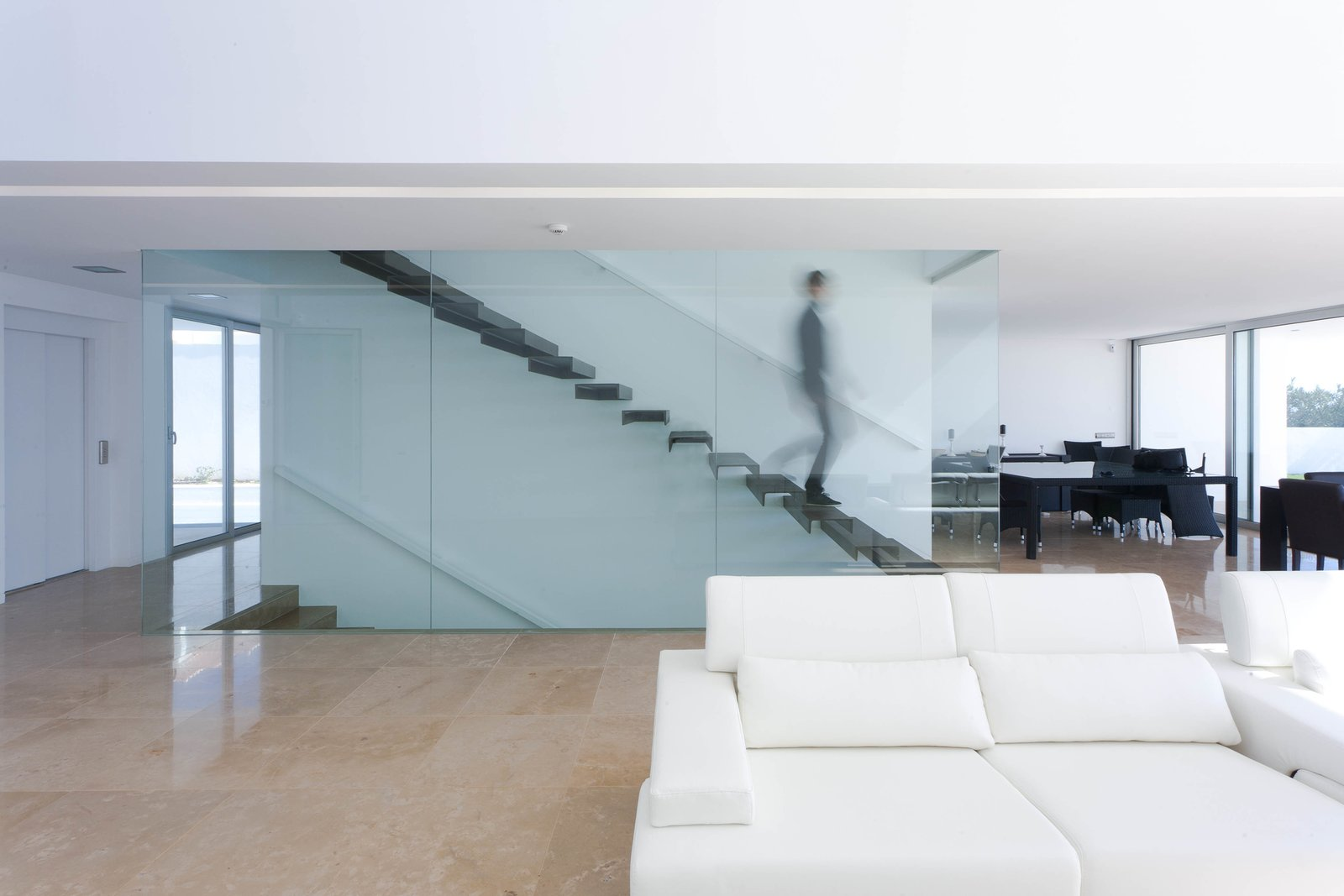 A floating staircase leads to the master bedroom with en suite bathroom, and a private terrace that affords the homeowner uninterrupted ocean views.  Photo 4 of 9 in Make This Seaside Villa in Southern Portugal Your Own Private Resort For $2M