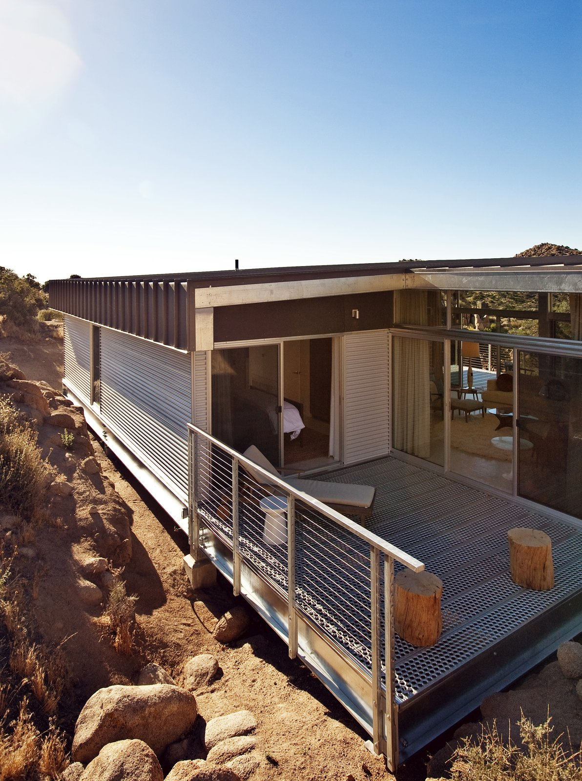 The back patio forms a corner between the master bedroom and main living area, creating a contemplative space for reading, relaxing, or simply enjoying the view.  Photo 7 of 8 in Offered at $674K, This Hybrid Prefab Is in Tune With the Californian Desert