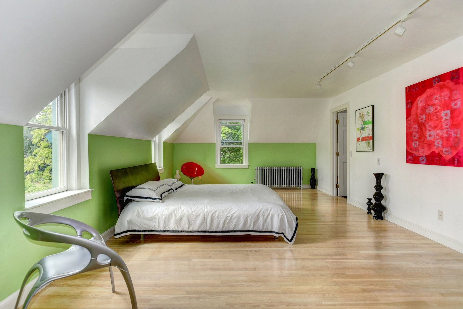 The master bedroom connects to a walk-in closet and a smaller room that is plumbed to become an ensuite bathroom, though it's currently an office.  Photo 7 of 9 in A Converted Firehouse Fit For an Artist Is Listed at $749K