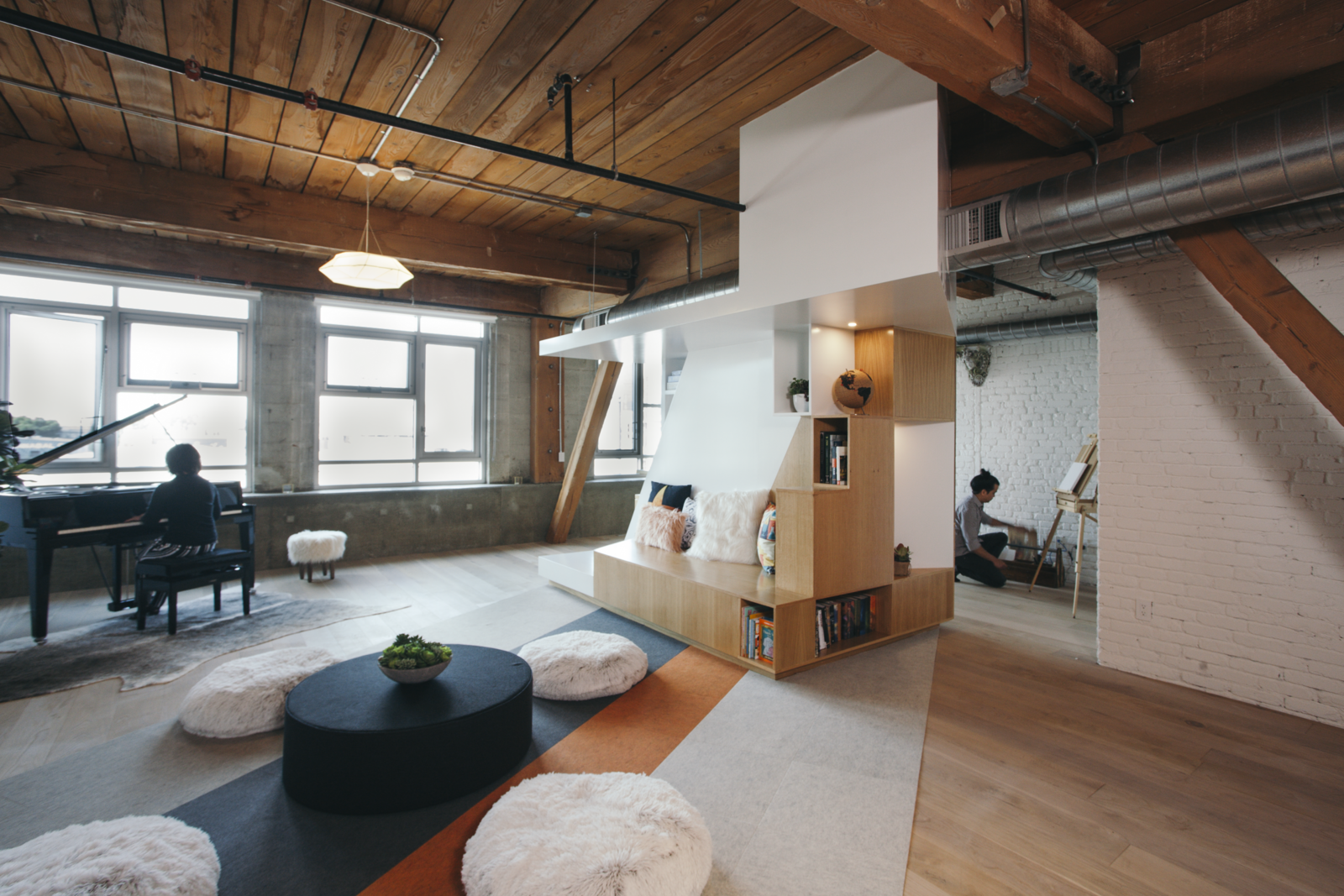 CHA:COL took acoustic concerns into consideration when designing the final environment. In addition to the one facade of windows, a Zaneen pendant illuminates the loft.  Photo 6 of 10 in Step Inside One Couple's Game-Changing Live/Work Loft