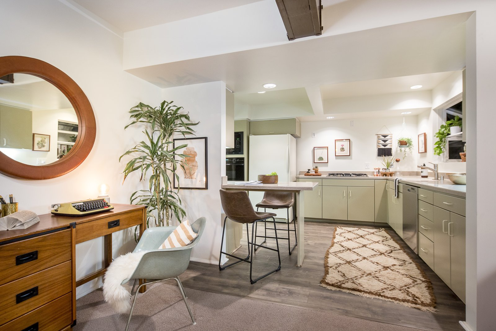 The living room leads to the kitchen, which features a pony wall for bar seating.  Photo 8 of 10 in A Modified A-Frame Overlooking Los Angeles Starts at $699K