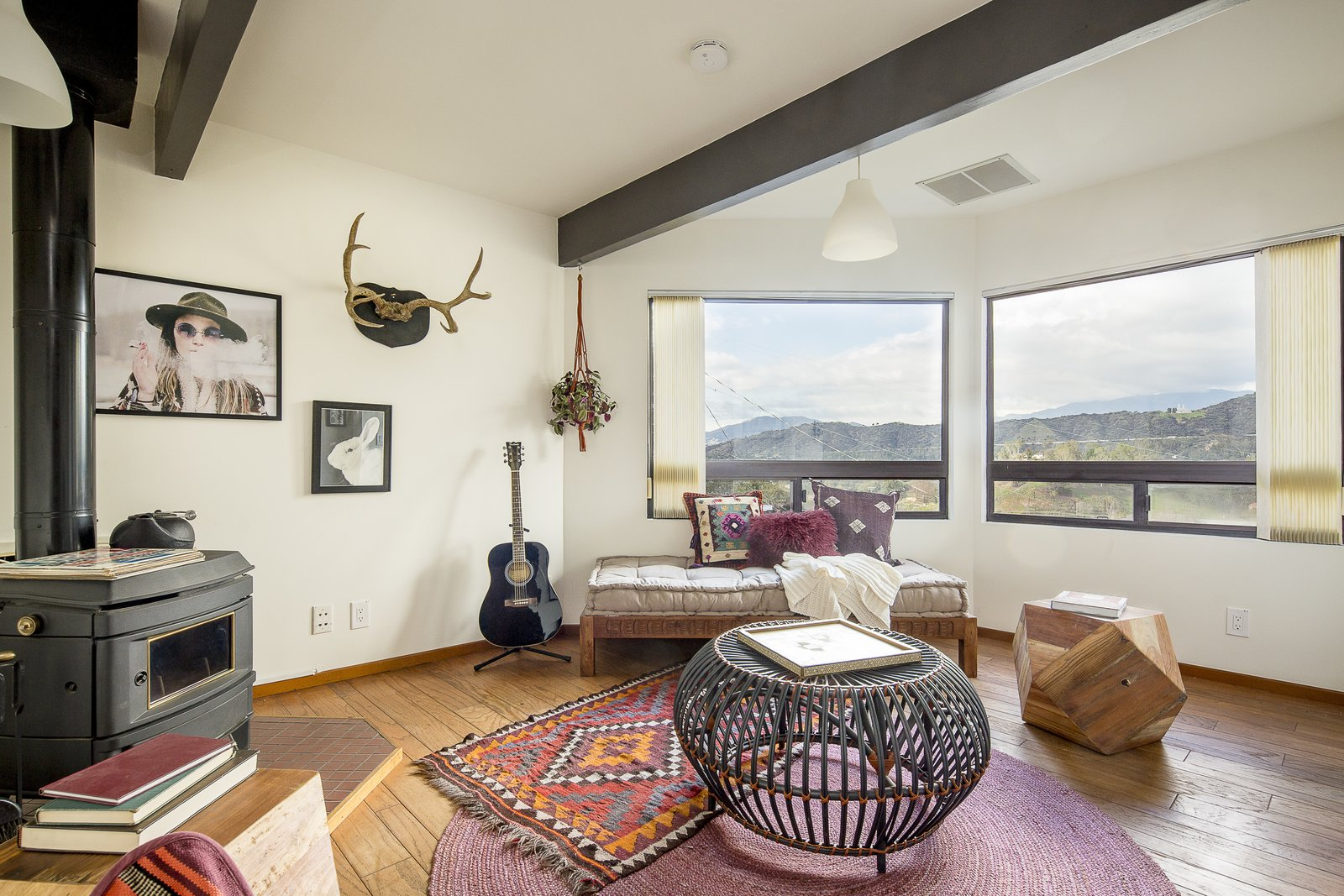 Complete with a Franklin stove, one of the bedrooms can be easily converted into an office or study.  Photo 10 of 10 in A Modified A-Frame Overlooking Los Angeles Starts at $699K