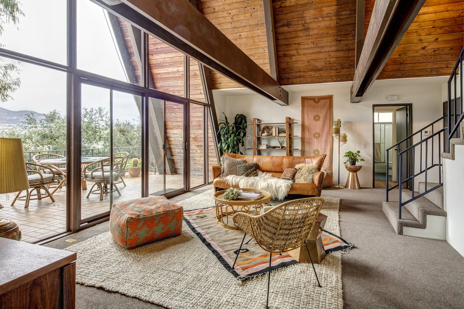 The home recently saw new roofing, carpeting, and painting, as well as an updated HVAC system. The glass northern exposure ensures that the space is awash in natural light.  Photo 5 of 10 in A Modified A-Frame Overlooking Los Angeles Starts at $699K