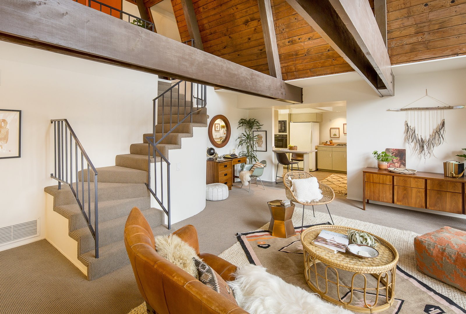 Descending the staircase, you enter the open living area. Says the seller's son of the 1,701-square-foot space,  Photo 4 of 10 in A Modified A-Frame Overlooking Los Angeles Starts at $699K