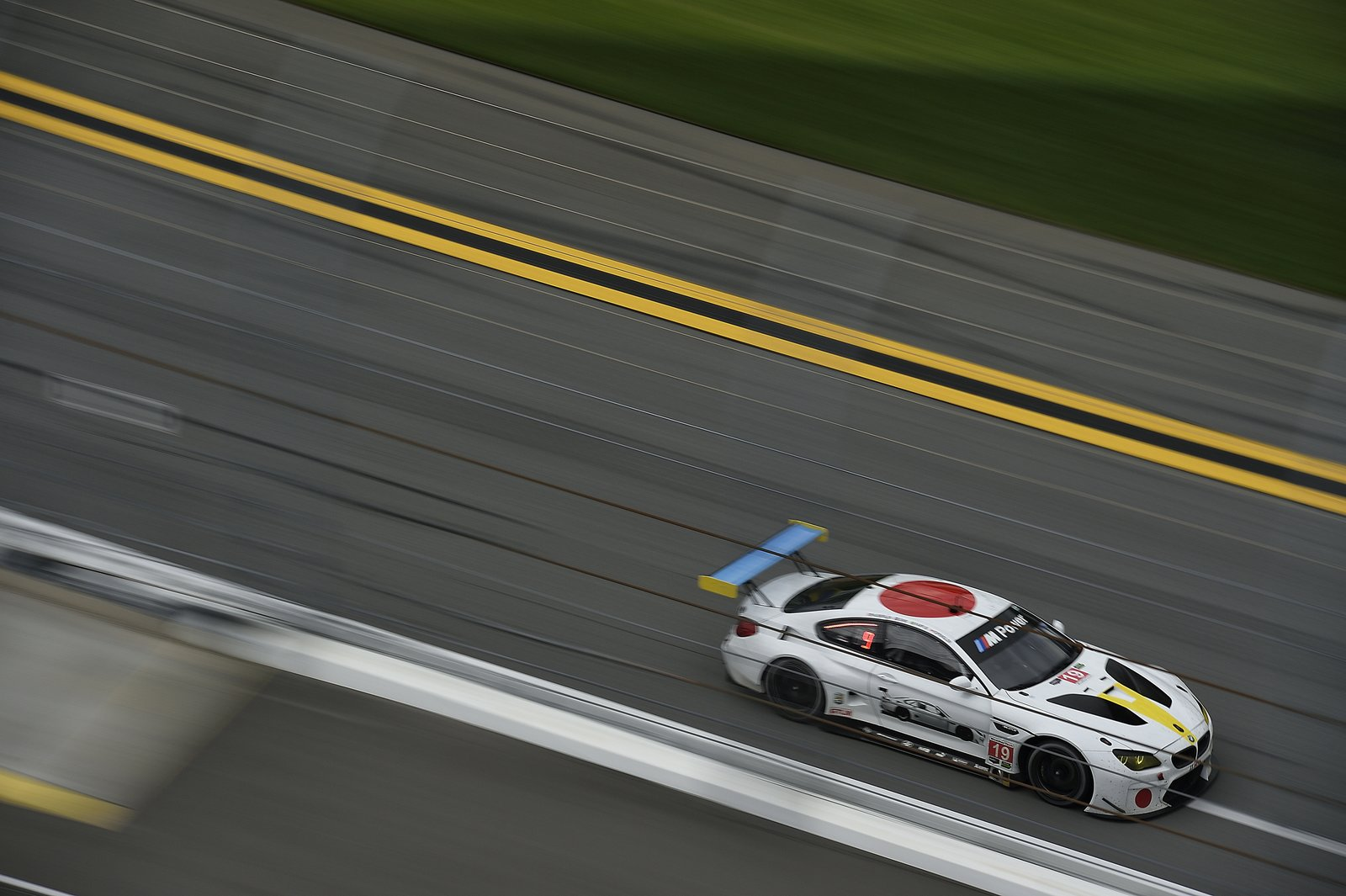 The image of a car appears on one side of the BMW Art Car #19, using two- and three-dimensional elements to add ambiguity to the work.  Photo 6 of 12 in John Baldessari Blazes a Trail at the Daytona International Speedway With BMW Art Car #19