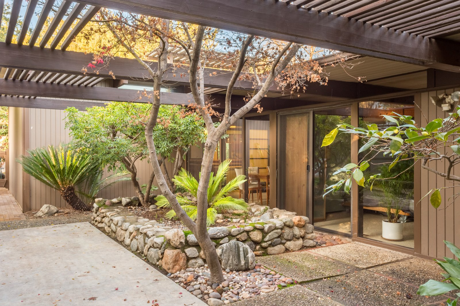 The dining room and bedrooms lead to a large garden patio.  Photo 9 of 11 in Snag This Midcentury Stunner in Southern California For $799K