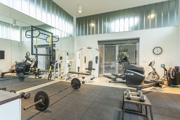 Currently, the pool house is set up as a home gym.  Photo 10 of 10 in For the Entertainer, This $5.5M Home in Southern California Fits the Bill