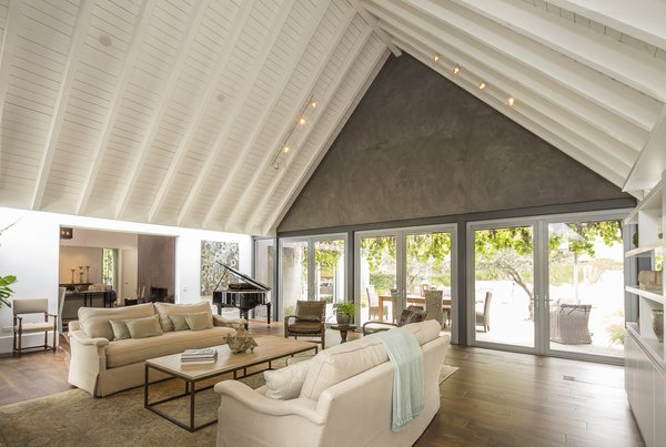 The entire rear of the living room opens up to the back patio, creating an integrated entertainment space. Van Scoter describes seating 100 people for dinner between the indoor and outdoor areas.  Photo 4 of 10 in For the Entertainer, This $5.5M Home in Southern California Fits the Bill