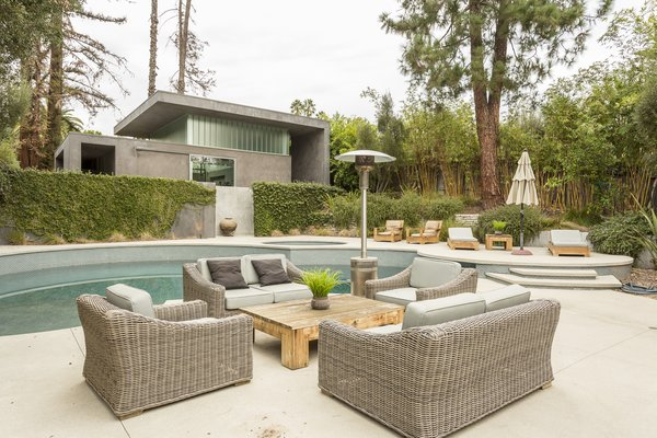 A pool and hot tub divide the main house from the pool house, which has two showers, storage space, and utilities—making it an ideal guesthouse or in-law unit.  Photo 9 of 10 in For the Entertainer, This $5.5M Home in Southern California Fits the Bill
