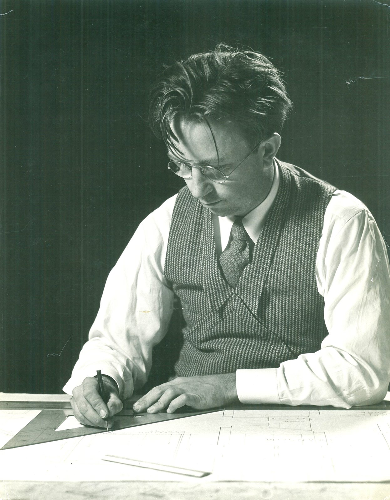 Alden B. Dow works at his drafting table in 1937, the year he wins the Diplome de Grand Prix for residential architecture at the Paris International Exposition. The fifth of Herbert and Grace Dow's seven children, Alden graduated from Midland High School and studied chemical and mechanical engineering at the University of Michigan before leaving for the Columbia University School of Architecture. In 1933, he spent a summer as a Taliesin Fellow under the tutelage of Frank Lloyd Wright, with whom he struck up a lifelong friendship.  Photo 2 of 8 in Alden B. Dow: The Mastermind of Midwestern Modernism