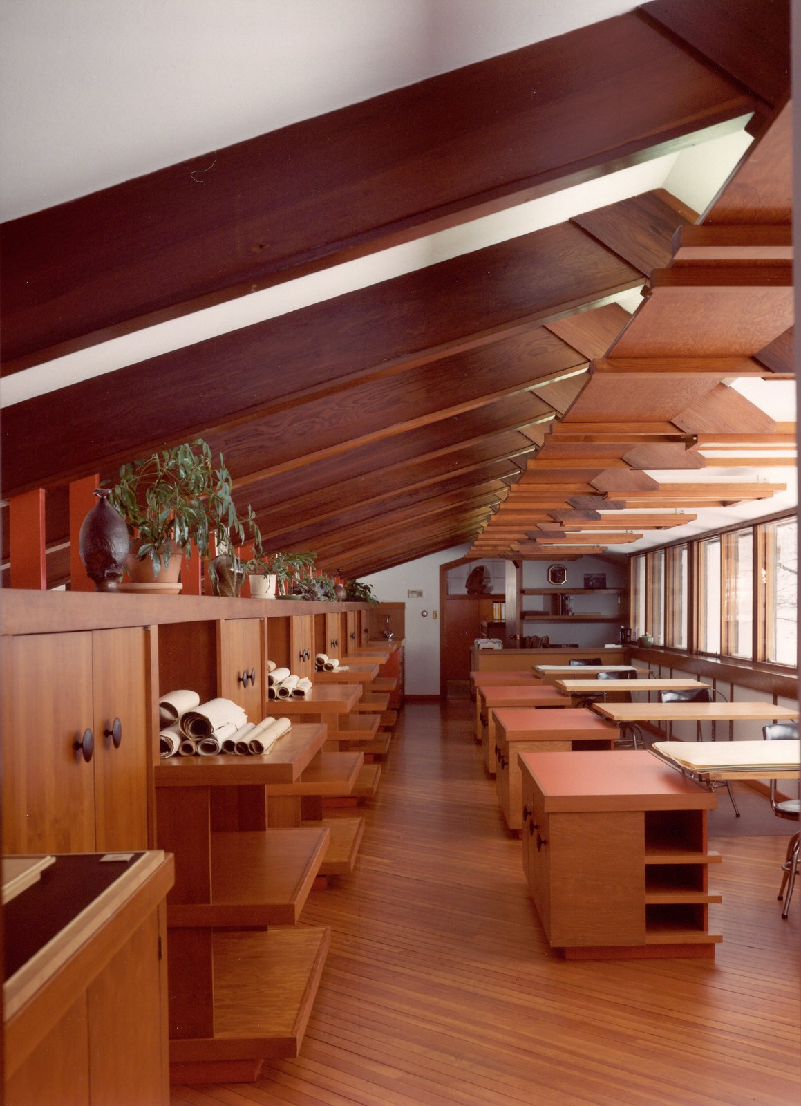 In the first drafting room, a row of windows on the northern facade provides illumination for the drafting tables below. The chairs are original, while the desks are reproductions of the flat tabletops that allowed Dow to offer suggestions as he walked down the aisle.  Photo 4 of 8 in Alden B. Dow: The Mastermind of Midwestern Modernism