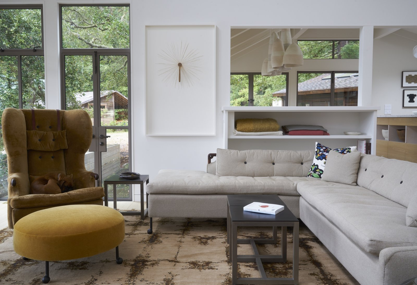 The living room features furniture from BDDW. Much of art arrayed throughout the home was collected through auctions; Southern Exposure and The Luggage Gallery are two favorite sources.  Photo 3 of 7 in A Northern Californian Renovation Brings Warmth to the Wilderness