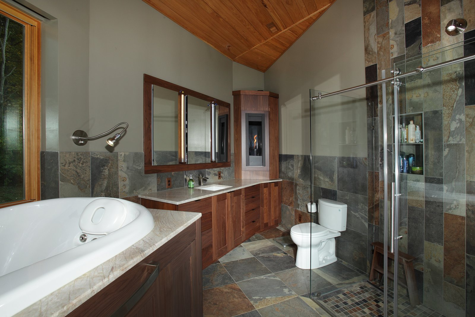 The tree that produced the white oak for the master bathroom previously grew in the same spot.  Photo 4 of 7 in A Round Pennsylvania Prefab Offers 360-Degree Solutions in Sustainability