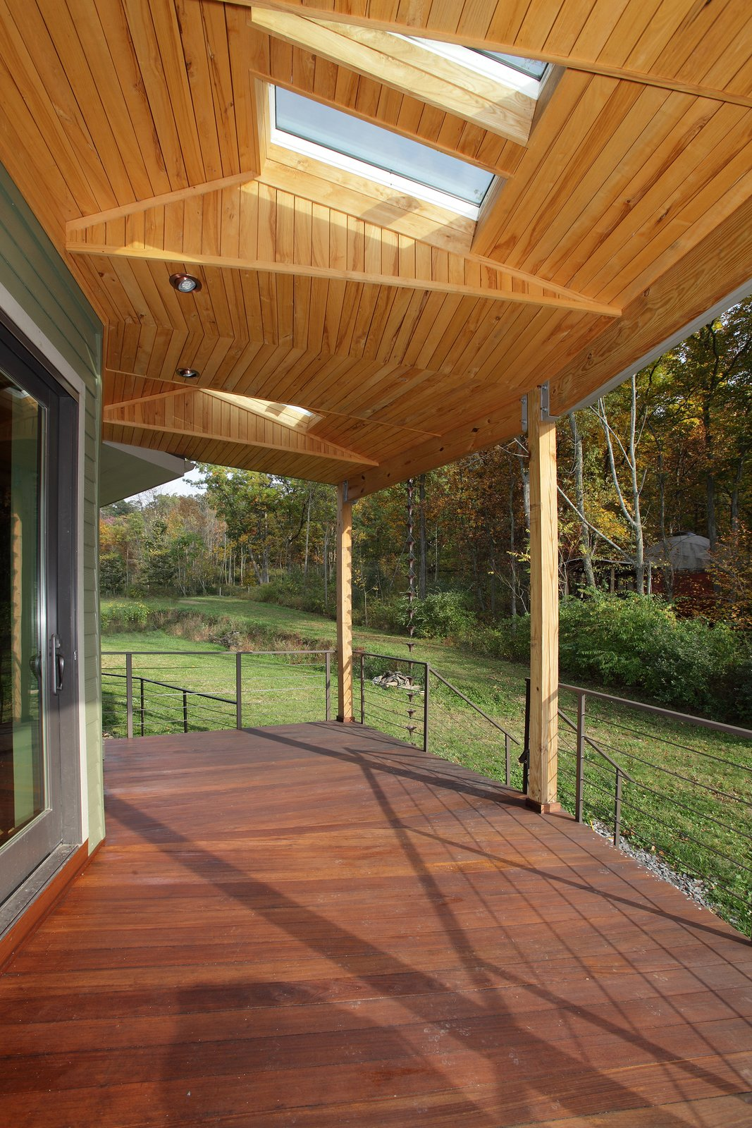 The round home provides panoramic views of the surrounding woods and water.  Photo 6 of 7 in A Round Pennsylvania Prefab Offers 360-Degree Solutions in Sustainability