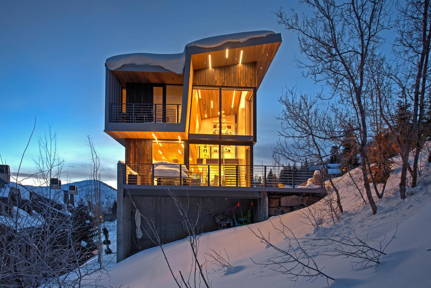 Exterior, Cabin Building Type, and Wood Siding Material The shou sugi ban exterior siding stands as a bold contrast in the snow, and is  Photo 10 of 10 in A Plunging Roof Carves Out Space in This Park City Home Offered at $2.4M