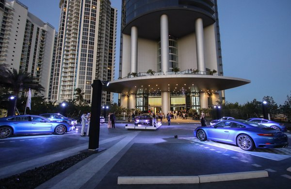 Guests begin to arrive at the porte-cochere entrance for the grand opening celebration on Saturday, March 18, 2017.  Photo 9 of 11 in Porsche Design's Lavish Residential Tower in Miami Lifts Residents and Cars Sky High