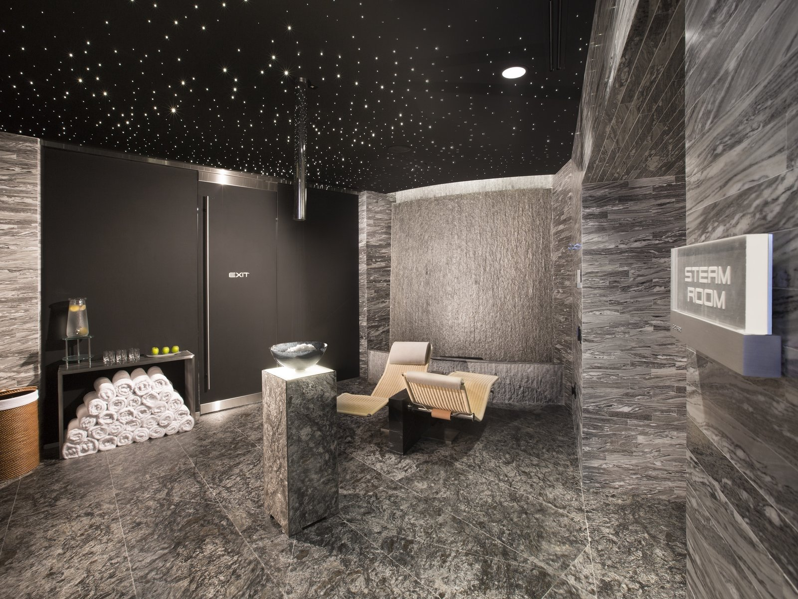 The state-of-the-art spa includes a steam room and sauna, treatment rooms, and Vichy showers. A fitness center, yoga room, and salon are also in the building.  Photo 6 of 11 in Porsche Design's Lavish Residential Tower in Miami Lifts Residents and Cars Sky High