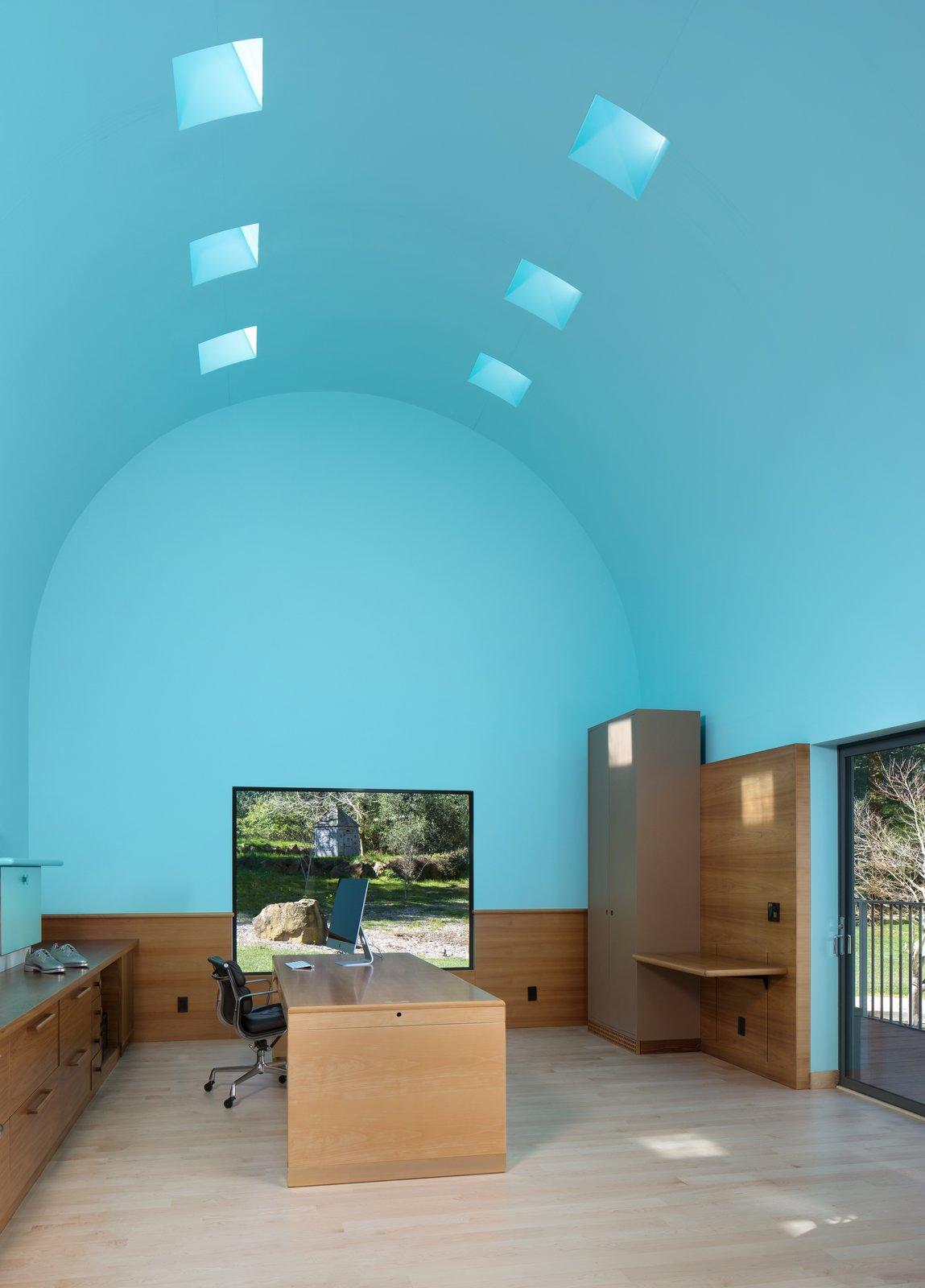 Office, Chair, Desk, Light Hardwood Floor, and Storage The office boasts an 18-foot, barrel-vaulted ceiling, an architectural metaphor for inspiration and exaltation.  Photo 6 of 12 in IDEO Founder David Kelley Asks $13.5M For His Ettore Sottsass-Designed Masterpiece
