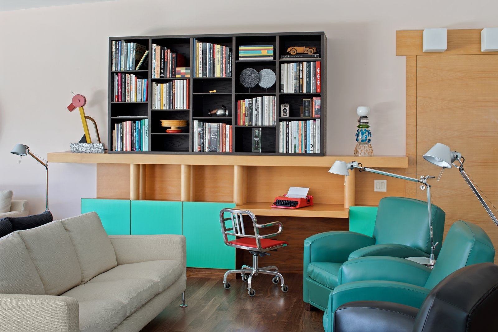Custom built-in furniture is found throughout the home, such as this piece in the living room. The Tahiti lamp, an abstracted and geometric bird shape, was designed for the 1981 Memphis collection, and the Olivetti Valentine typewriter turned a piece of office equipment into a fashion accessory.  Photo 5 of 12 in IDEO Founder David Kelley Asks $13.5M For His Ettore Sottsass-Designed Masterpiece