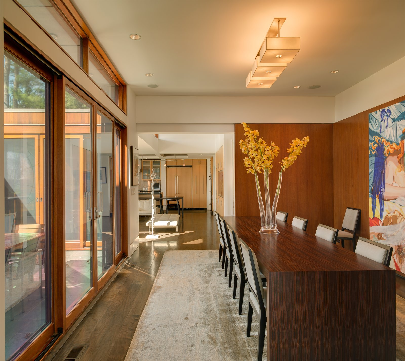 The formal dining room can open onto the terrace as well, while sliding pocket doors give the option of privacy and intimacy.  Photo 6 of 8 in An Eliot Noyes Transformation in Connecticut Honors the Experimental Spirit of the Original