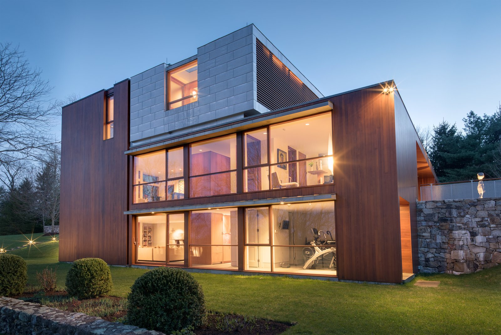 """A zinc-clad addition complements the cedar-clad structure, emphasizing the """"abstract formal precepts of Noyes' design,"""" says Moore.  Photo 8 of 8 in An Eliot Noyes Transformation in Connecticut Honors the Experimental Spirit of the Original"""