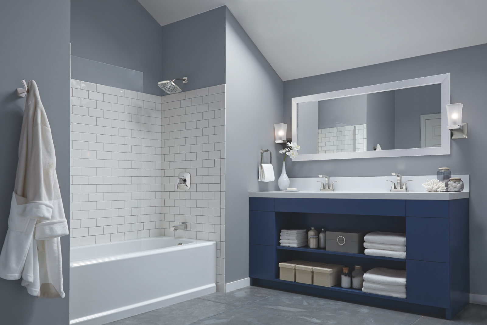 Bathroom with grey painted walls and an alcove tub and shower accented with white subway tiles.