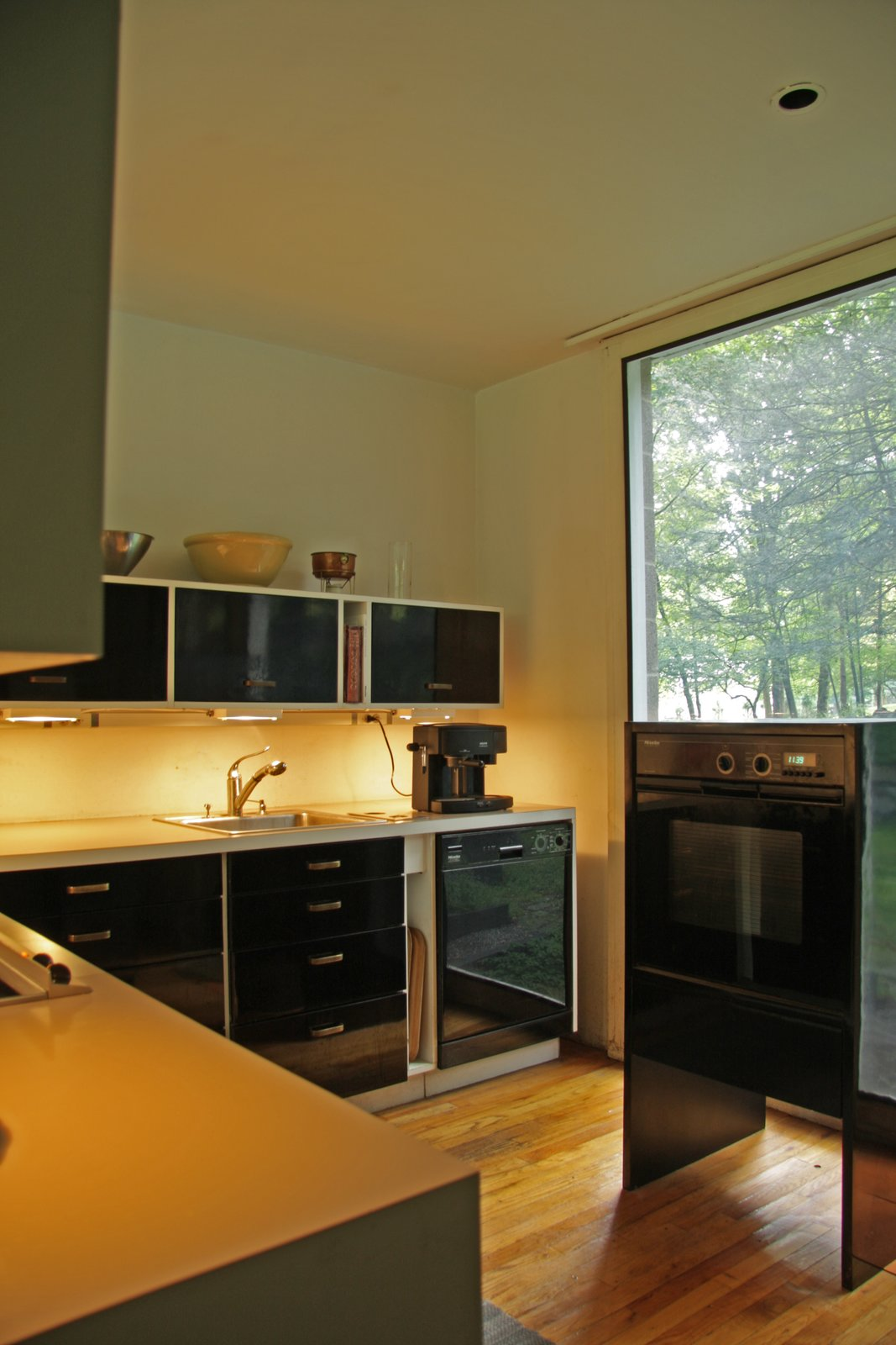 The original kitchen was designed by the Booths, and Robert renovated it in 2000, making it ergonomic for his wife Sirkka's shorter frame.  Photo 6 of 10 in With $1 Million, You Can Save Philip Johnson's First Commissioned House