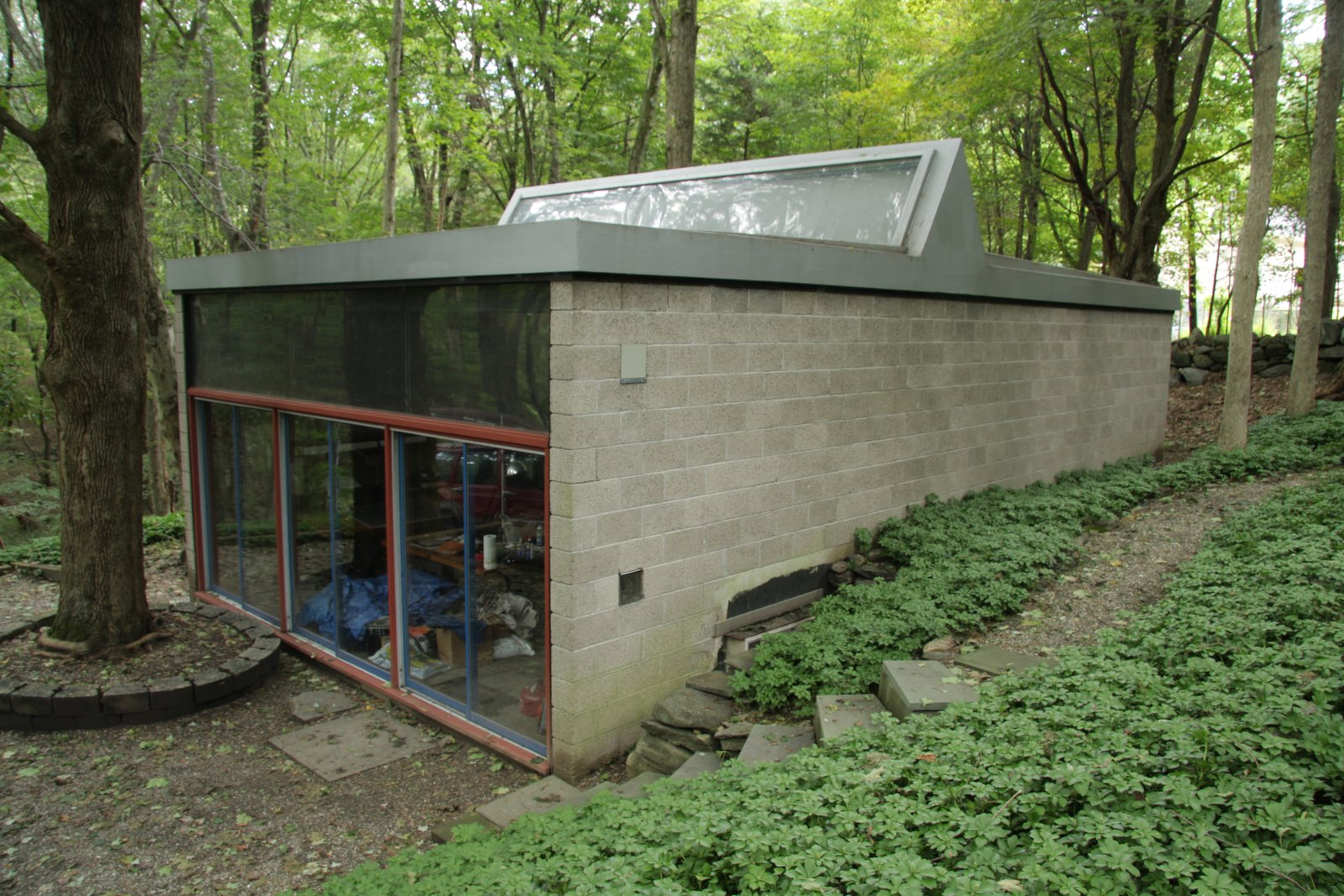 Built in the early 60s, the separate concrete-and-glass studio echoes the original home.  Photo 8 of 10 in With $1 Million, You Can Save Philip Johnson's First Commissioned House